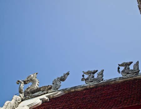 White Hussadee gable apex on the temple roof in Thai style Stock Photo - 16431730