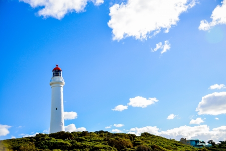 White lighthouse with blue sky Stock Photo