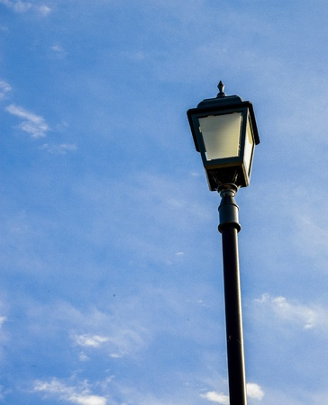 Light pole with blue sky photo