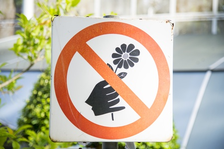 Do not pick the flowers sign photo