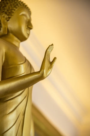Golden image of Buddha photo