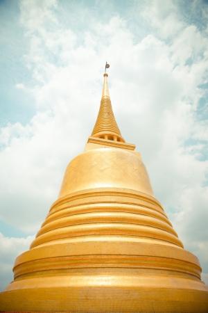 Golden pagoda in Wat Sraket Thailand