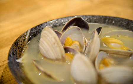 Boiled clam with soup in Japanese style photo
