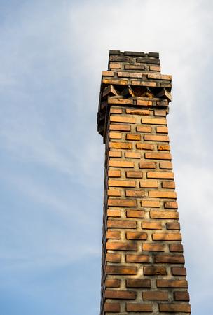 Chimney brick with blue sky photo