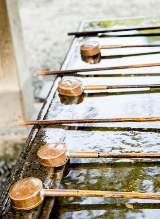 purified: Dippers for wash hand in front of Japanese temple