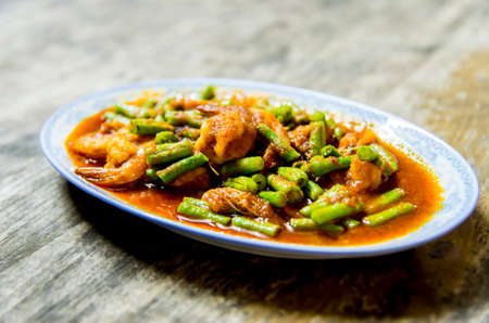 Shrimp with red curry in Thai style photo