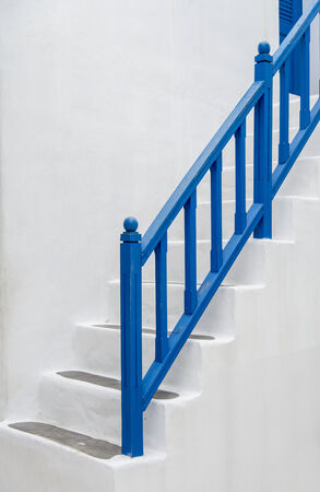 Blue handrail with white stairs2 photo
