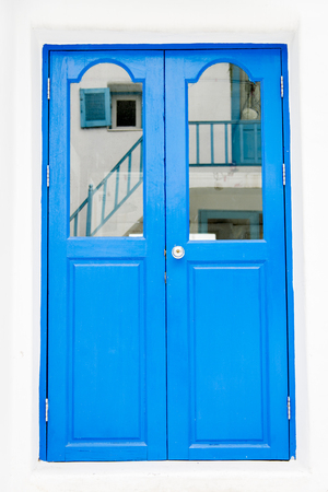 Blue wooden door on white wall photo