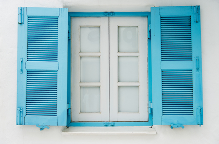 Blue wooden window on white wall6 photo