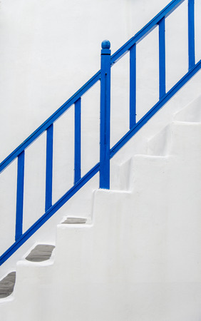 Blue handrail with white wall1 photo