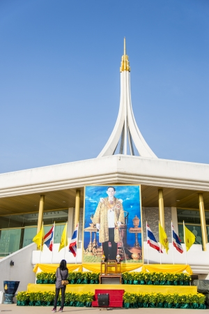 Lady with Photo of King in Thailand Stock Photo - 24582256