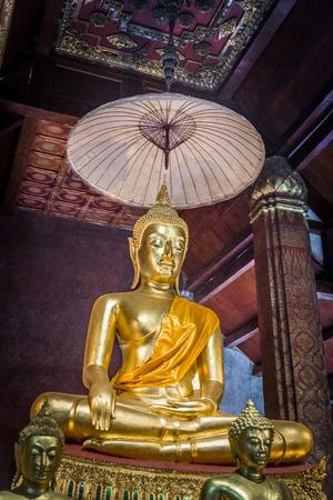 Golden Buddha statue are in the Buddhist temple