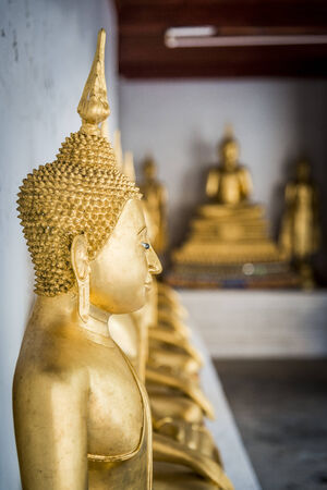 Row of Buddha statue in the Thai temple Stock Photo