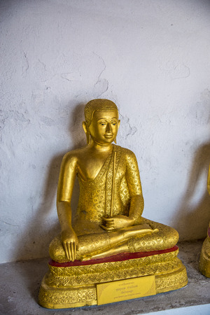 Sitting Golden Buddha statue in the Thai Temple photo