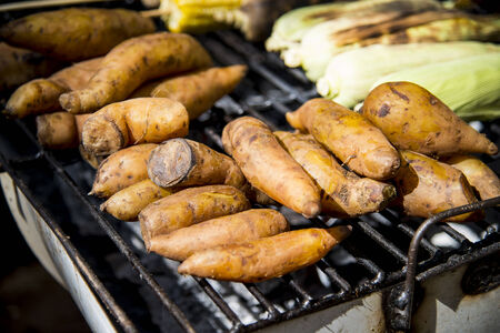 Sweet potato on barbecue photo