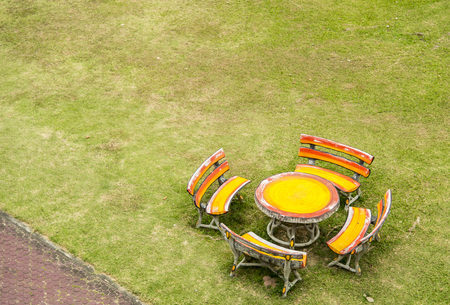 Chairs and Table set in the garden photo