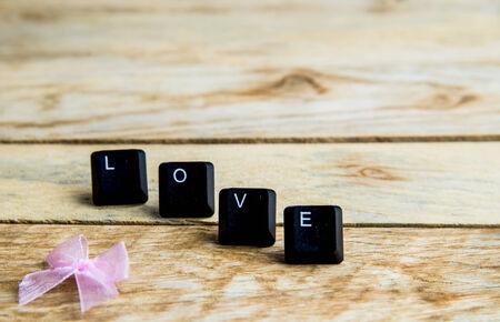 spelled: Love word on the wooden floor