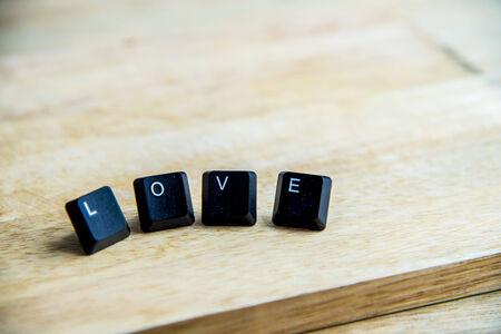 Love word on the wooden floor photo
