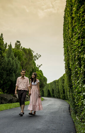 Lovely couple walk together in the garden photo