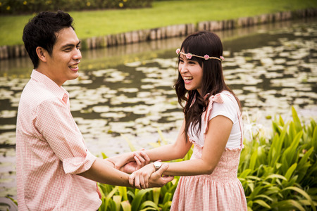 Lovely couple hold the hands in the garden Stock Photo