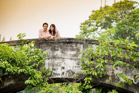 Lovely couple on the bridge photo