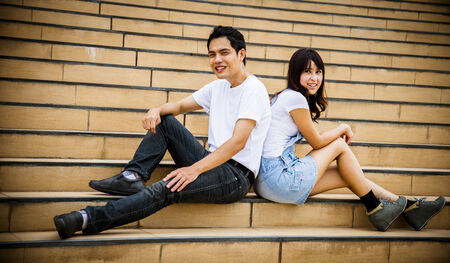 Lovely couple sit on the stairs Stock Photo