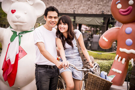 Lovely couple in the amusement park1
