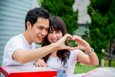 Lovely couple with love hand sign3 Stock Photo