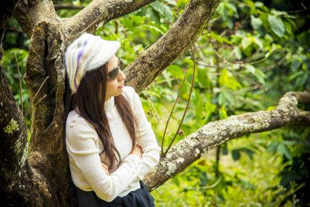 Loneliness women under the cherry photo