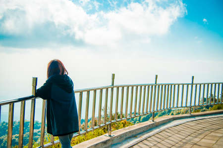 Lonely woman stand near steel fence and see the sky2 photo