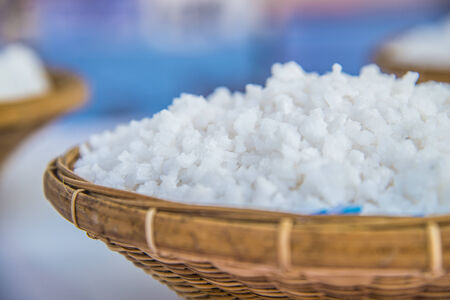 sulfate: White Coarse kosher salt in basketwork Stock Photo