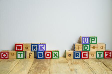 create idea: Wooden block create idea word on wooden floor1