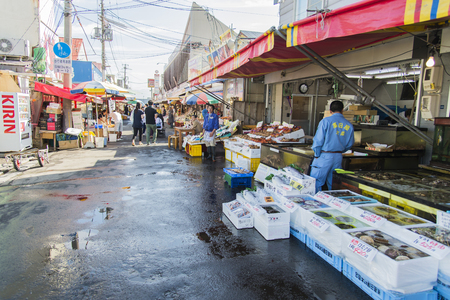 HAKODATE, JAPAN - JULY 20 Japanese merchant are in Morning market on July 20, 2013 in Hakodate, Japan  Morning market in Hakodate is famous market in Japan Stock Photo - 28848584