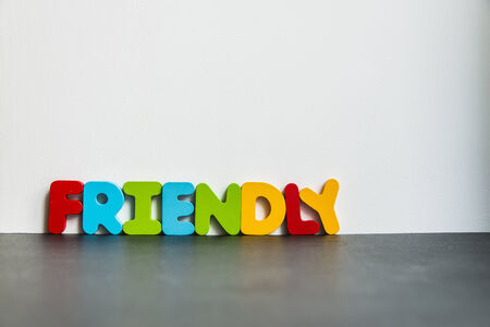 Colorful wooden word Friendly on white background