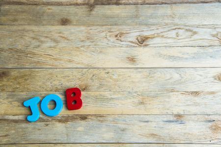 Colorful wooden word Job on wooden floor