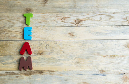 Colorful wooden word Team on wooden floor3 photo