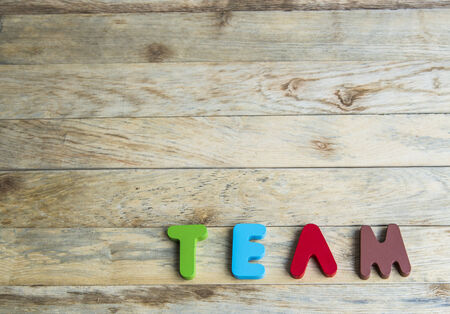 Colorful wooden word Team on wooden floor4 photo