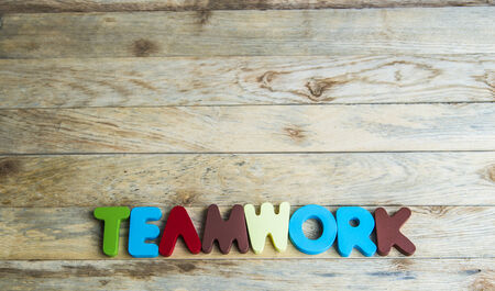 Colorful wooden word Teamwork on wooden floor Stock Photo