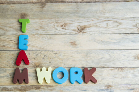 Colorful wooden word Teamwork on wooden floor2 photo