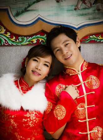 Couple with qipao suit in Chinese temple2 photo