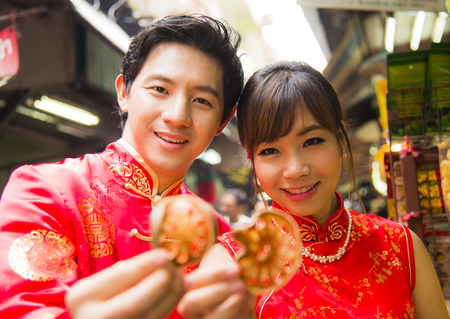 Couple with qipao suit show dried beal photo