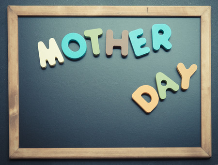 Mother day wooden word on black board1 photo