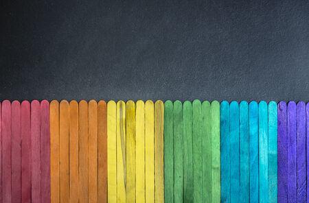 Colorful wooden stripe on black board 4 photo