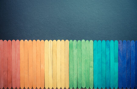 Colorful wooden stripe on black board 5 photo
