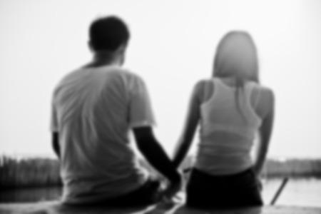 siluette: Couple sit on sunset beach in Blur style