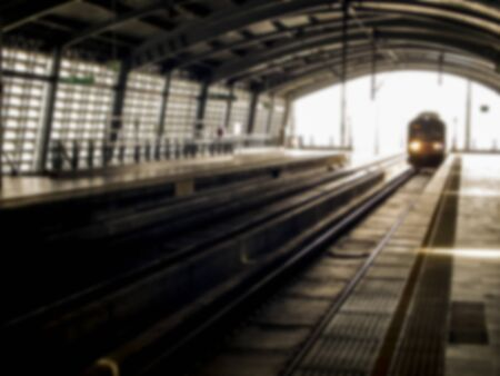 come in: Train come the track at station in Blur style