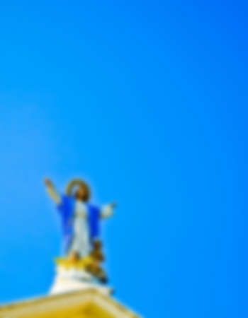 Jesus statue with blue sky in Blur style photo