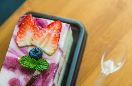 blue berry: Blue berry cheese cake on wooden plate