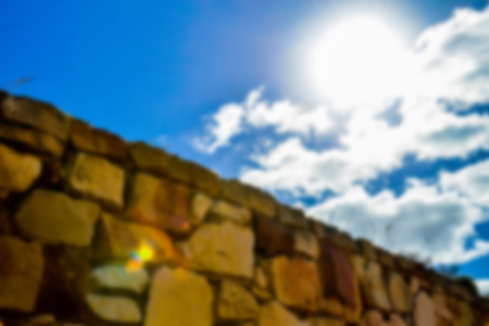 Stone wall with blue sky in Blur style photo