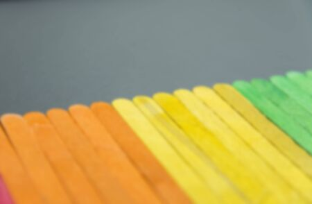 Colorful wooden stripe on black board in Blur style photo